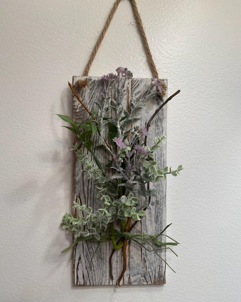 wooden hanging block with faux plants creeping out of it