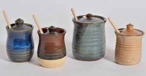 multiple storage pots with wooden spoons